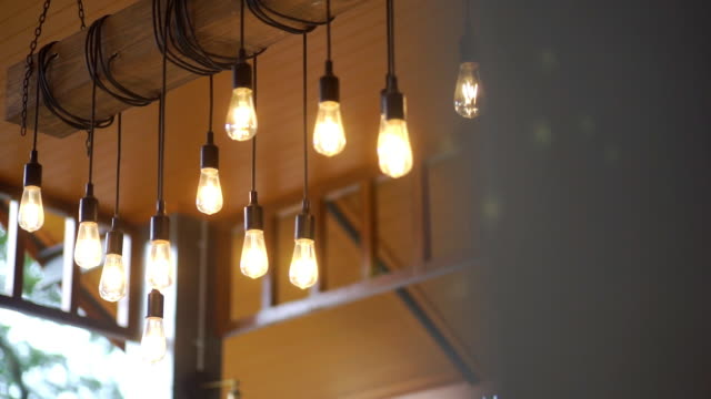 a group of retro lighting decor in the room - filament stock videos & royalty-free footage