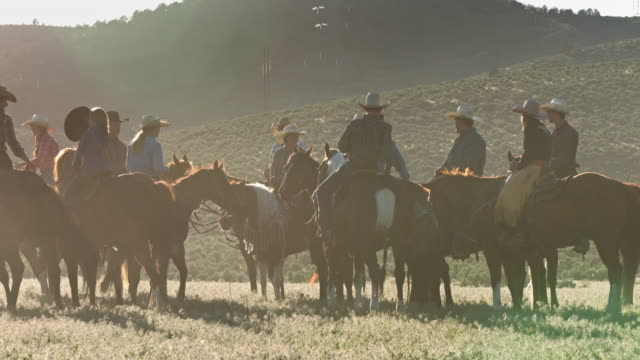 group of riders in western clothing chatting on horseback - cowgirl stock videos & royalty-free footage