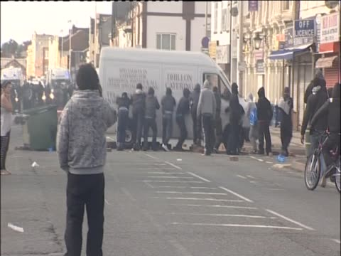 group of rioters rocking van in west bromwich - dondolarsi video stock e b–roll