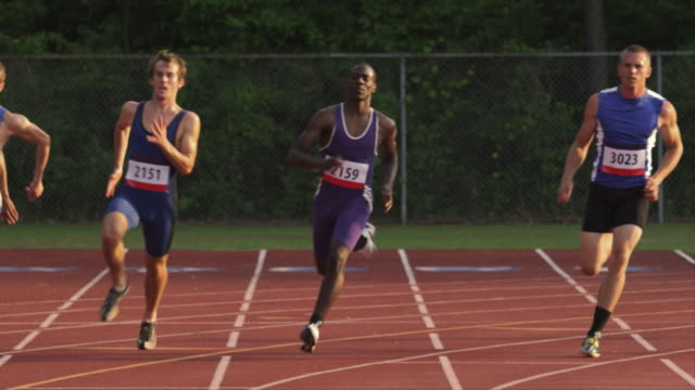 a group of runners race along a track. - running shorts stock videos & royalty-free footage