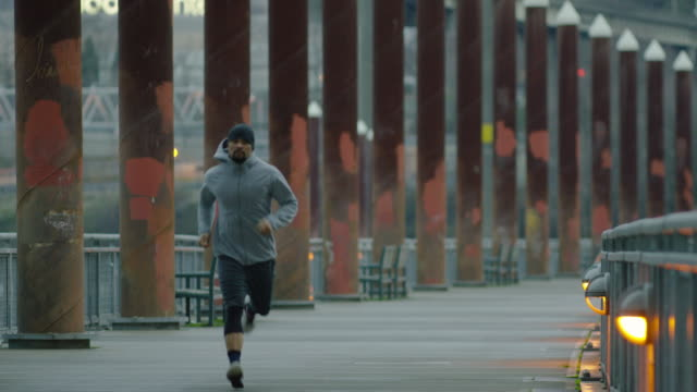 group of runners running outside in urban city setting - finishing stock videos and b-roll footage