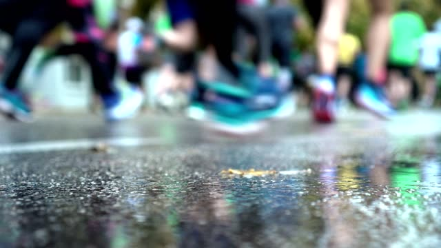 group of running people on the city road - unrecognisable person stock videos & royalty-free footage