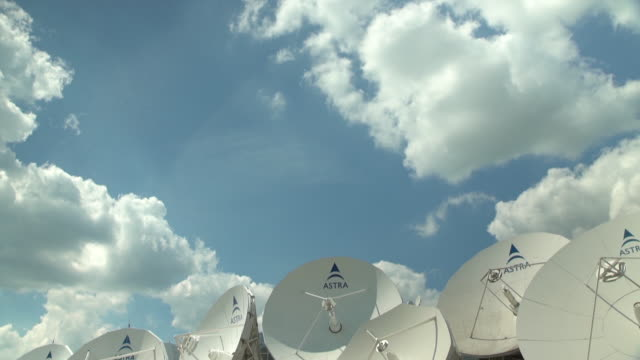 group of satellite dishes at broadcasting upload area - serie televisiva video stock e b–roll