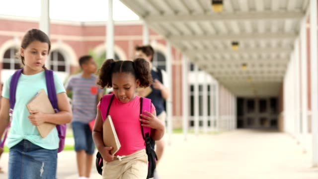 group of school children, friends walking together on campus. - junior high stock videos & royalty-free footage