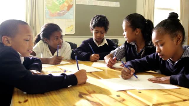 group of school children smile to camera - school uniform stock videos & royalty-free footage