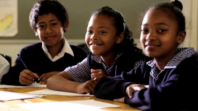 group of school children smiling to camera - school uniform stock videos & royalty-free footage