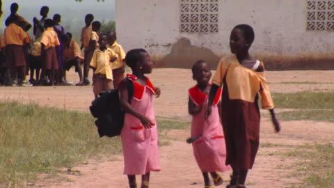 ms group of school children walking through school yard, tamale, ghana - girls stock videos & royalty-free footage