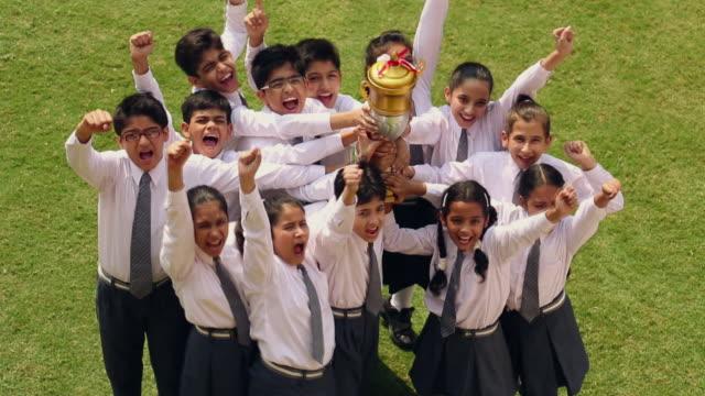 group of school students celebrating success, noida, uttar pradesh, india - cup stock videos & royalty-free footage
