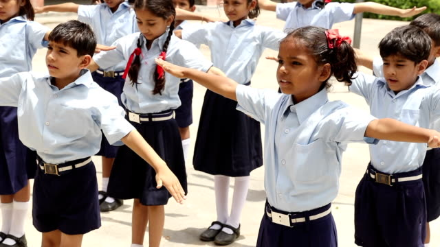 Group of school students doing exercising, Haryana, India