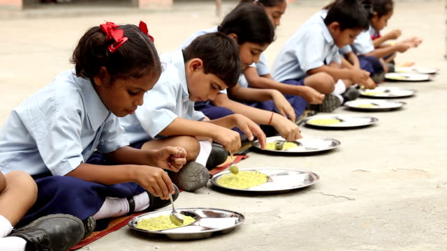 group of school students eating midday meal, haryana, india - school building stock videos & royalty-free footage