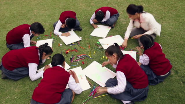 Group of school students making drawing, Noida, Uttar Pradesh, India