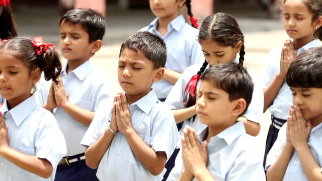 group of school students praying, haryana, india - religion stock videos & royalty-free footage