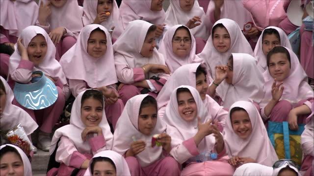 MS Group of schoolgirls sitting outdoors, Iran