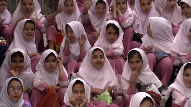 ms pan group of schoolgirls sitting outdoors, iran - iran stock videos & royalty-free footage