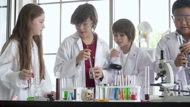 group of science students mixing the chemical in test tubes - measuring stock videos & royalty-free footage