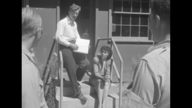 group of scientists in front of building / two shots of scientist dr david long standing on stairs of same building holding log book and talking to... - paramount building stock videos and b-roll footage