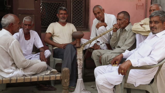 Group of senior men smoking hooka, Haryana, India