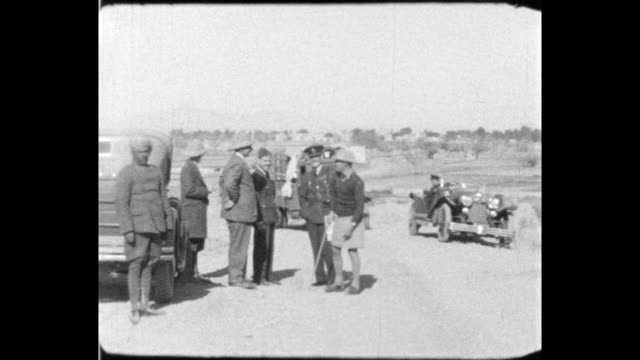 group of senior military officers meeting beside military vehicles before moving off in convoy raf officer drives large staff car towards camera... - colonial stock videos & royalty-free footage