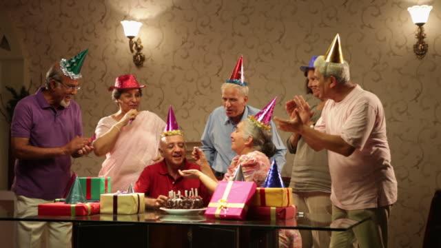 Group of senior people celebrating birthday party