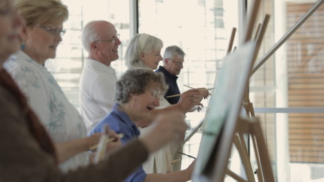ms zi selective focus group of senior people painting on easels in art class / vancouver, british columbia, canada - art class stock videos & royalty-free footage