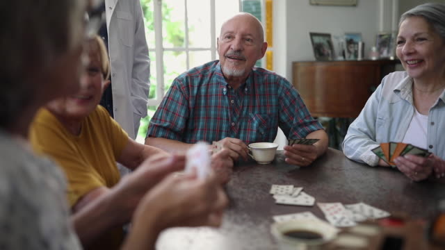 group of senior people playing cards at tea time - playing card stock videos & royalty-free footage