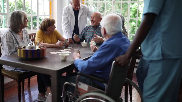 group of senior people playing cards at tea time - lifestyle stock videos & royalty-free footage