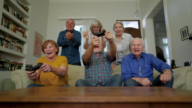 group of senior people playing video games and laughing - excitement stock videos & royalty-free footage