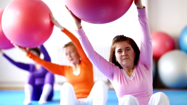 group of senior women doing pilates. - fitness ball stock videos & royalty-free footage