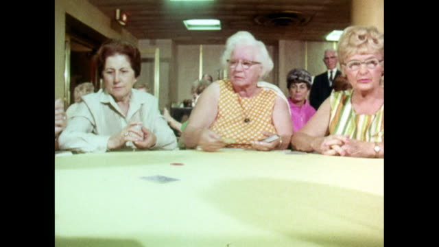 group of senior women play poker around table; 1969 - poker card game stock videos & royalty-free footage