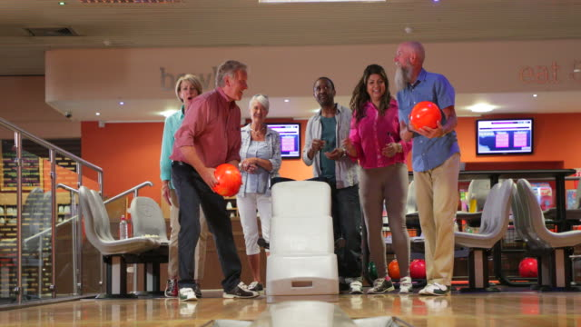 Group Of Seniors Bowling