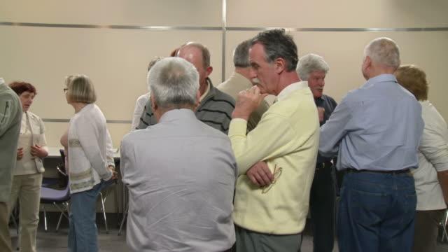hd: group of seniors during seminar break - summit meeting stock videos and b-roll footage