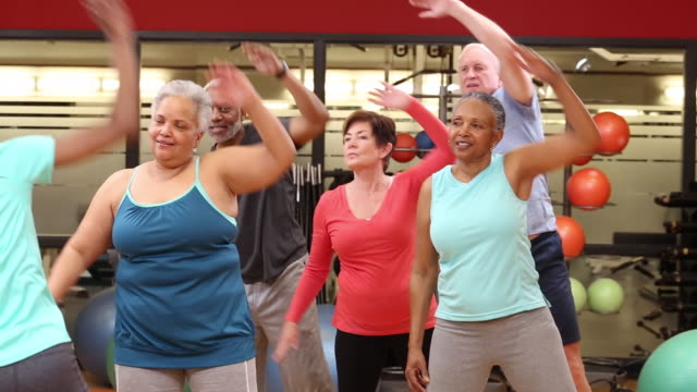 ws ds group of seniors exercising in fitness class at health club gym / richmond, virginia, united states - overweight active stock videos & royalty-free footage