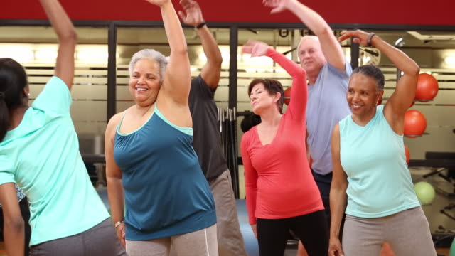 ws ds group of seniors exercising in fitness class at health club gym / richmond, virginia, united states - aerobics stock videos & royalty-free footage