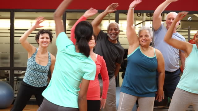 WS DS Group of Seniors Exercising in Fitness Class at Health Club Gym / Richmond, Virginia, United States