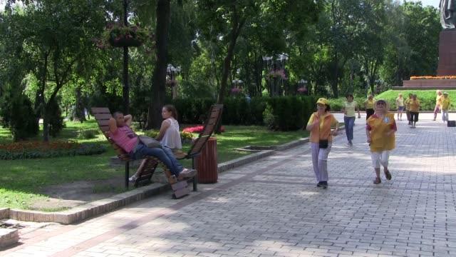 Group of seniors exercising in Taras Shevchenko Park in Kiev capital of Ukraine