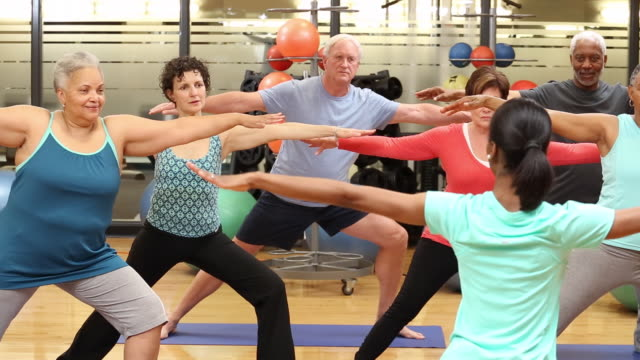 ws ds group of seniors exercising in yoga class at health club gym / richmond, virginia, united states - overweight yoga stock videos & royalty-free footage