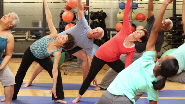 ws ds group of seniors exercising in yoga class at health club gym / richmond, virginia, united states - overweight active stock videos & royalty-free footage