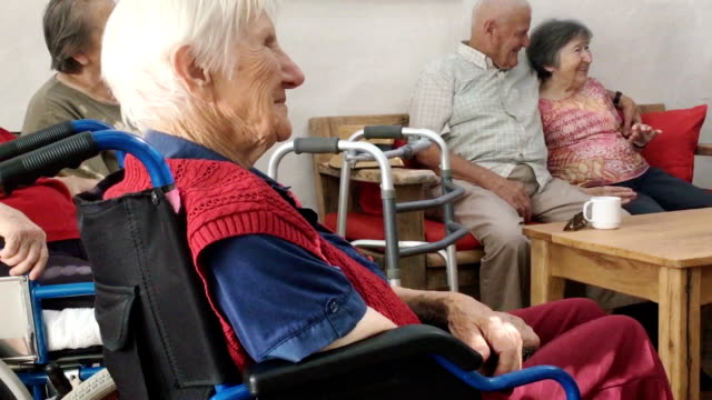 group of seniors socializing indoors - walking frame stock videos & royalty-free footage