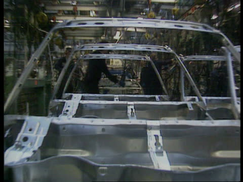 Liverpool Ellesmere Port MS Car bodies on production line at Vauxhall motors plant MS Car bodies being assembled TGV Workers in white coats in...