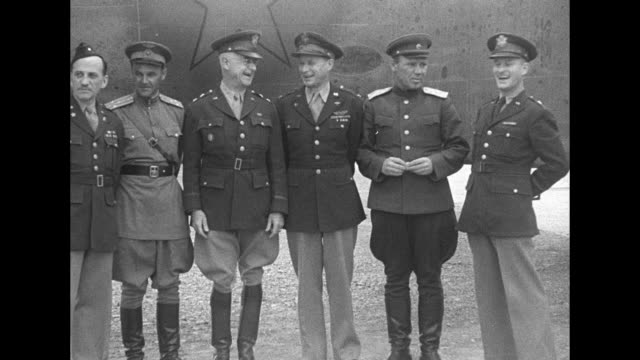 group of six american and soviet air force officers stand for photo op in front of warplane with american star insignia painted over to resemble... - russian ethnicity stock videos & royalty-free footage