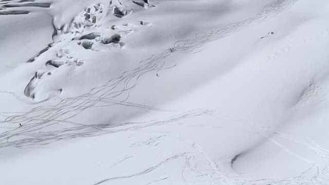 WS AERIAL group of skiers going down a huge glacier / chamonix, Haut savoir, france