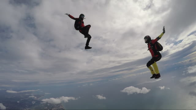 Group of skydivers playing in the air