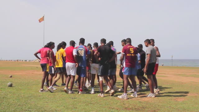 ws group of soccer players bonding in huddle during training exercises on galle face green esplanade - sri lanka stock videos and b-roll footage