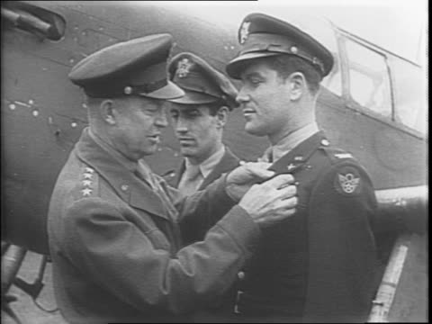 group of soldiers gathered on an airfield in england / general dwight d eisenhower presenting pilots with the distinguished service cross /... - pilot stock videos & royalty-free footage