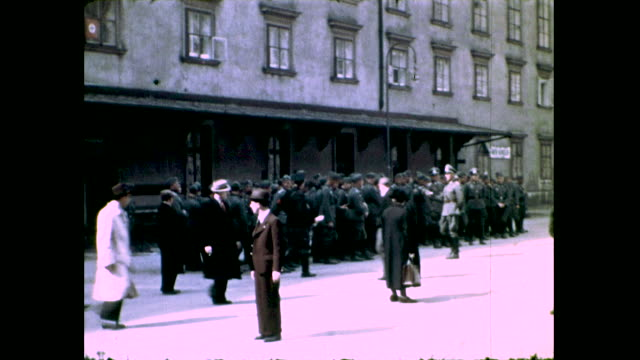 group of soldiers gathered on the street directed by officers, people and cars pass in the foreground - nazism stock videos & royalty-free footage