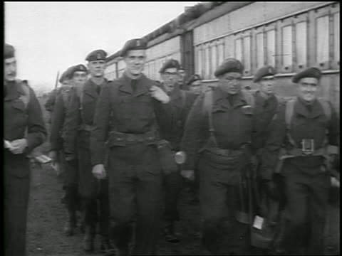b/w 1950 group of soldiers marching past parked train camera / newsreel - koreakrieg stock-videos und b-roll-filmmaterial