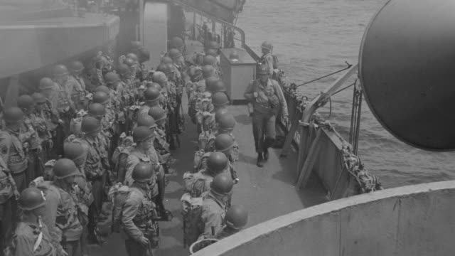 ms group of soldiers on deck of ship as they get their gear in order and receive instruction - traditional helmet stock videos and b-roll footage