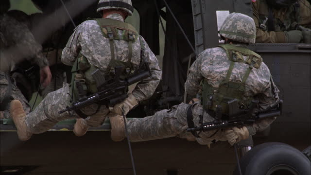 MS, TD, Group of soldiers rappelling from helicopter, USA
