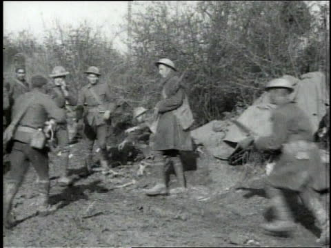 group of soldiers receive news of armistice soldiers jumping dancing and cheering / - waffenstillstand krieg stock-videos und b-roll-filmmaterial