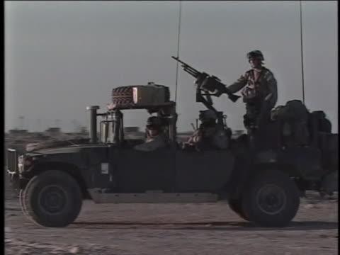 group of soldiers ride in a humvee. - al fallujah stock videos & royalty-free footage